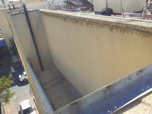 Сетка от голубей на 4-х этажном здании.